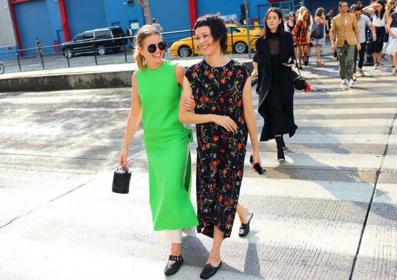 Megan Bowman Gray in a Celine dress with a Simon Miller bag and Celine shoes, and Patty Lu in a Balenciaga dress