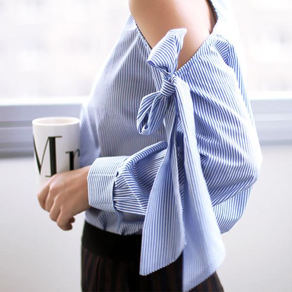 blue shirt open sleeves