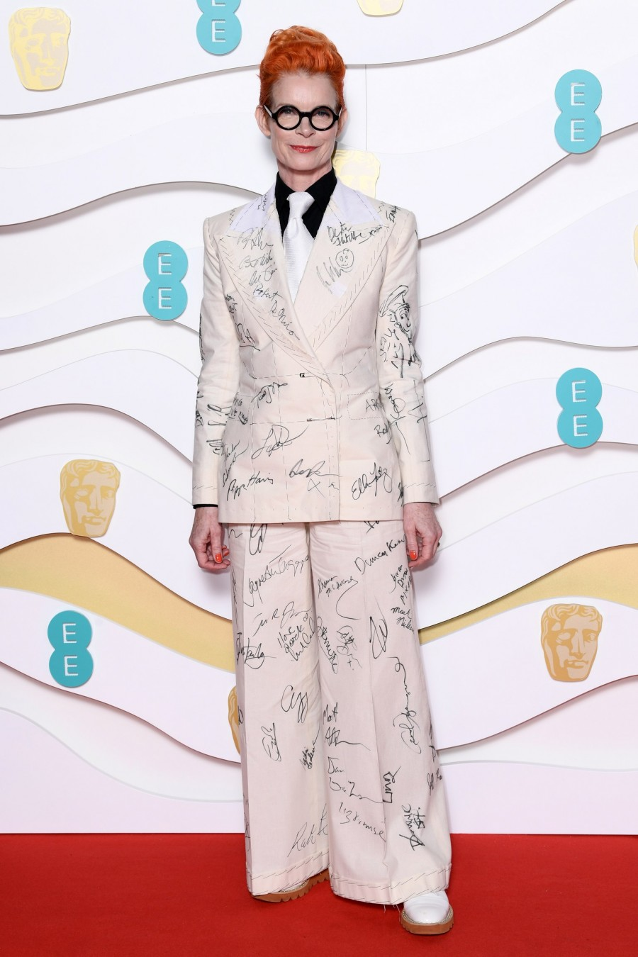 Sandy Powell in a suit designed by Ian Frazer Wallace – with the plan to auction it off once it was fully covered with signatures of celebrities.